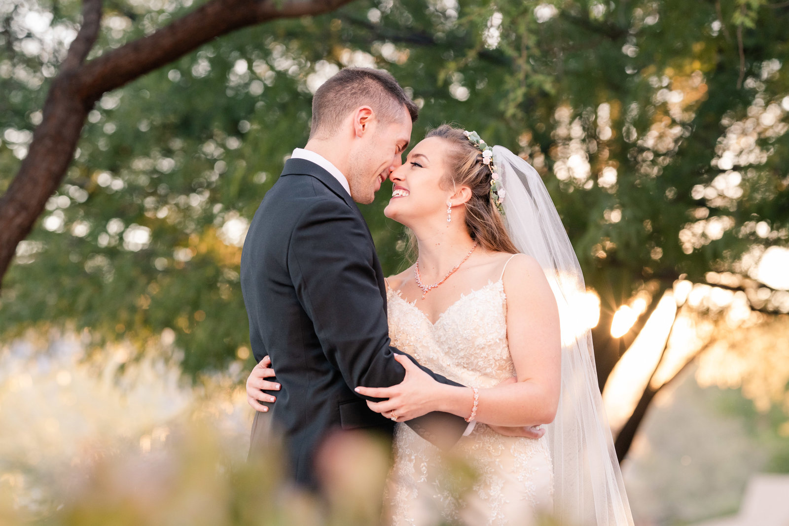 wedding couple kissing under tree at Sierra Vista church