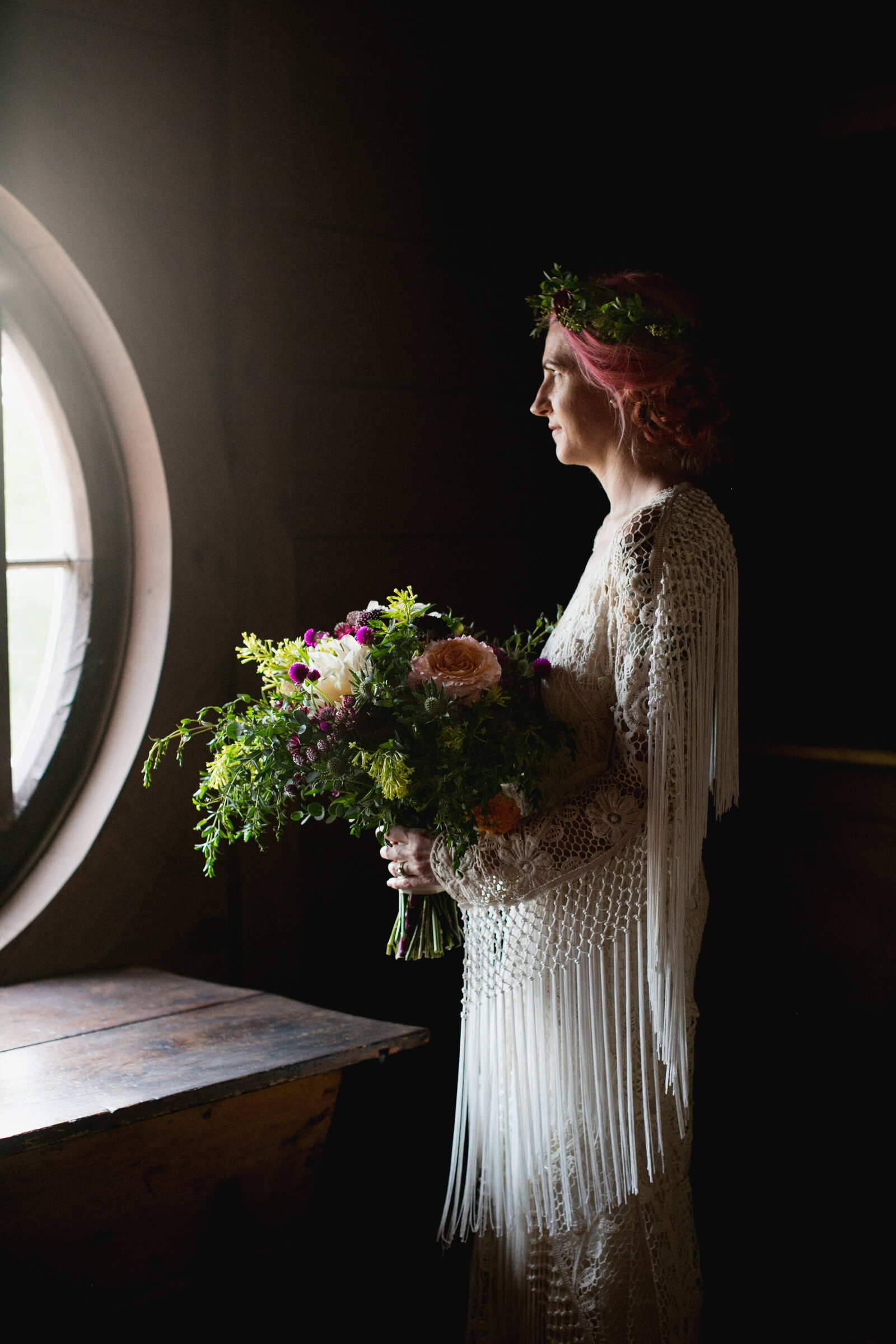 bride with fringe dress at window light