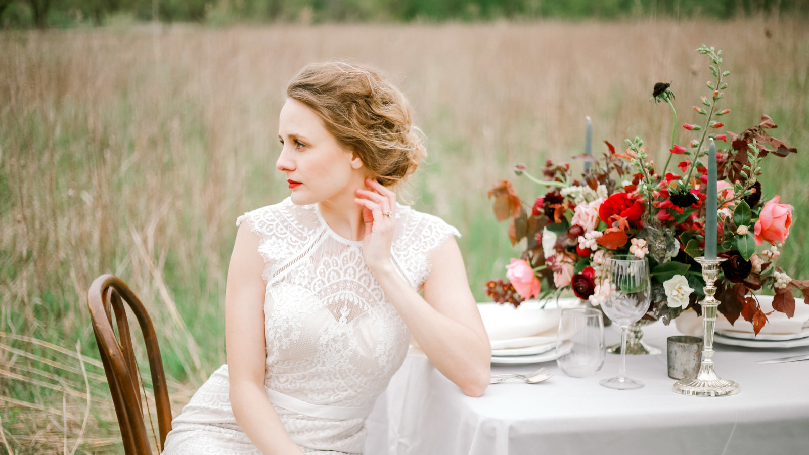 bride at sweetheart table with floral arrangement