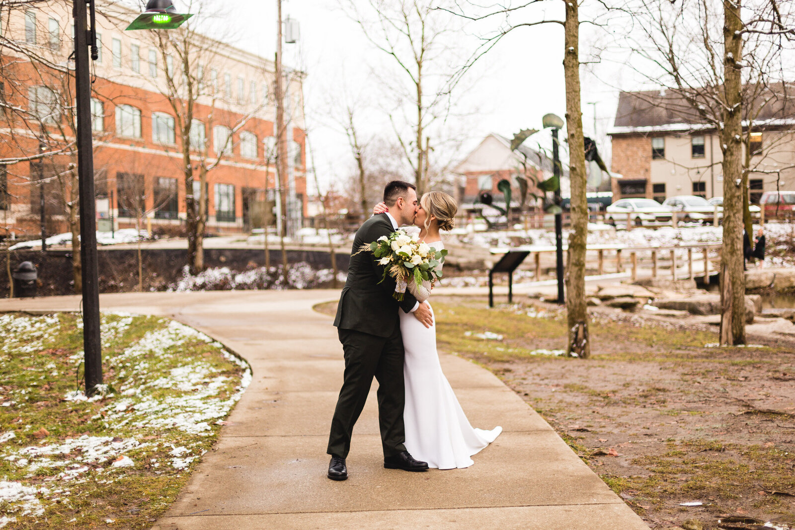 bride and groom kissing for portrait at winter ohio wedding