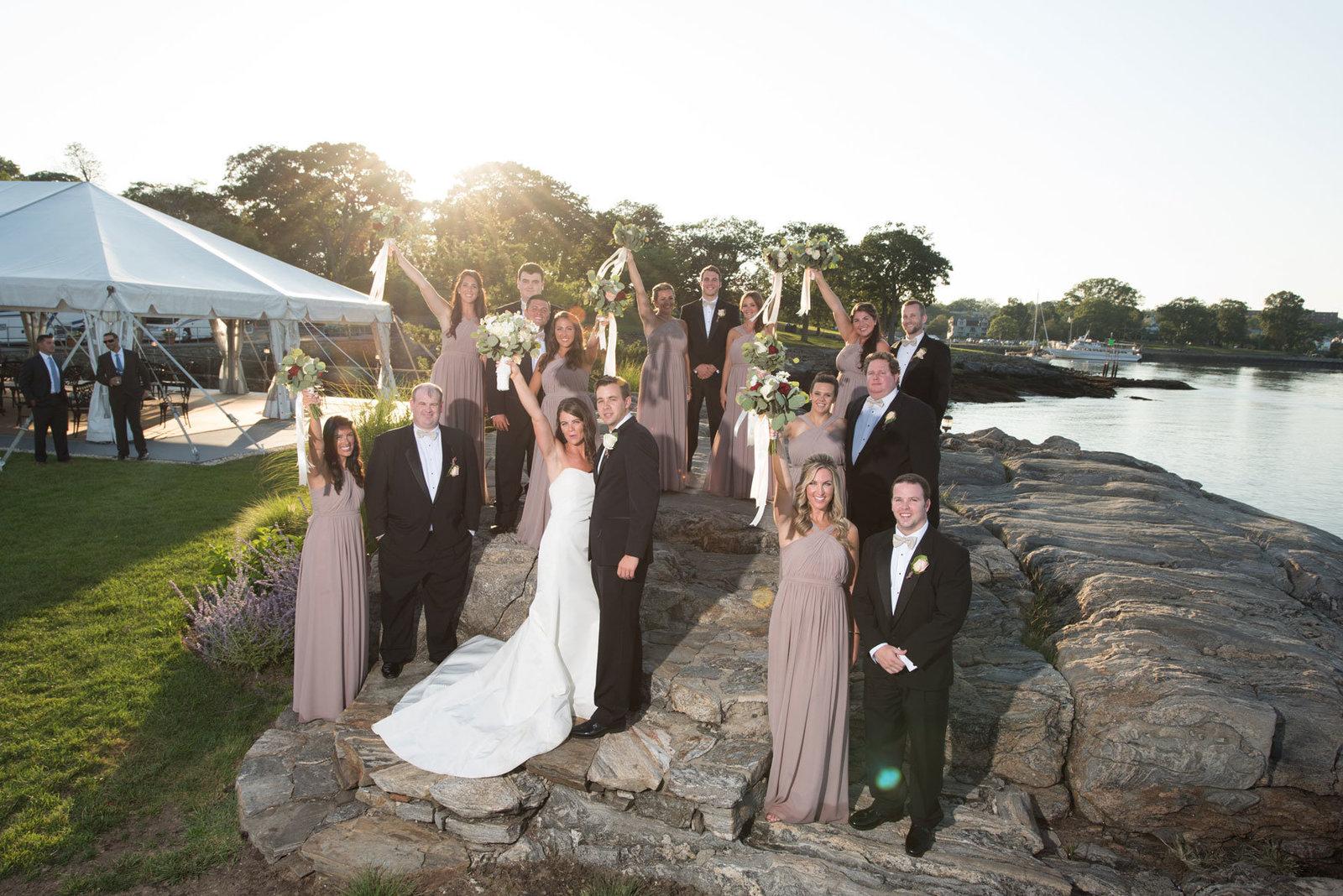 bride and groom with bridal party outside Glen Island Harbor Club
