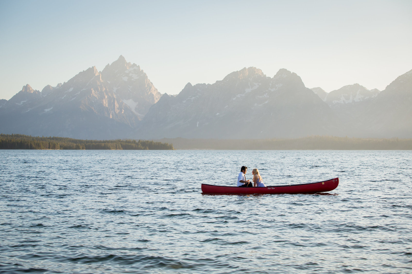 Jackson Lake engagement session in a canoe