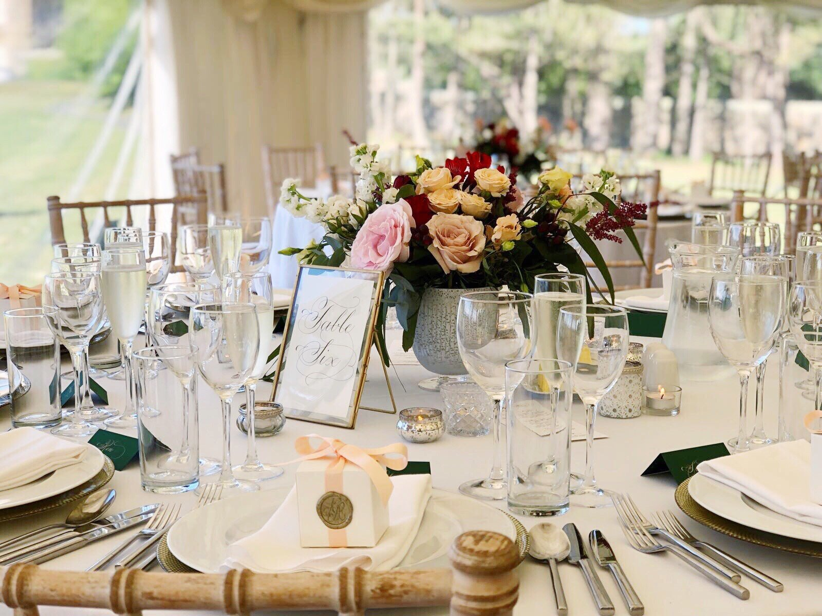 Scottish wedding table settings with calligraphy table number signs