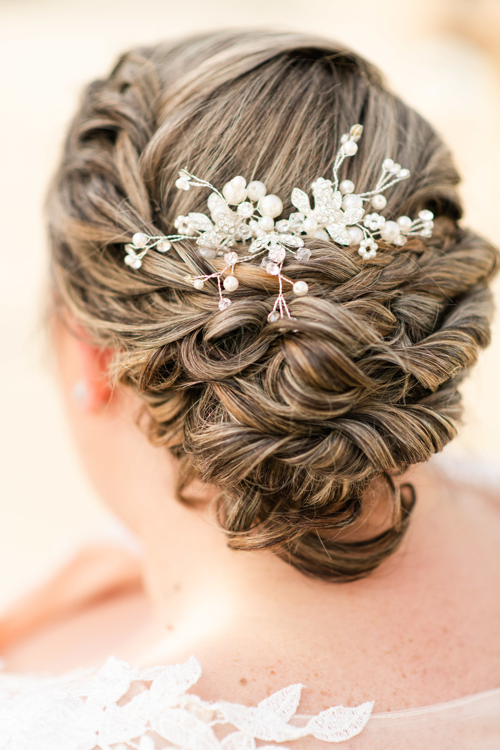wedding hairstyle for bride with intricate hairpiece