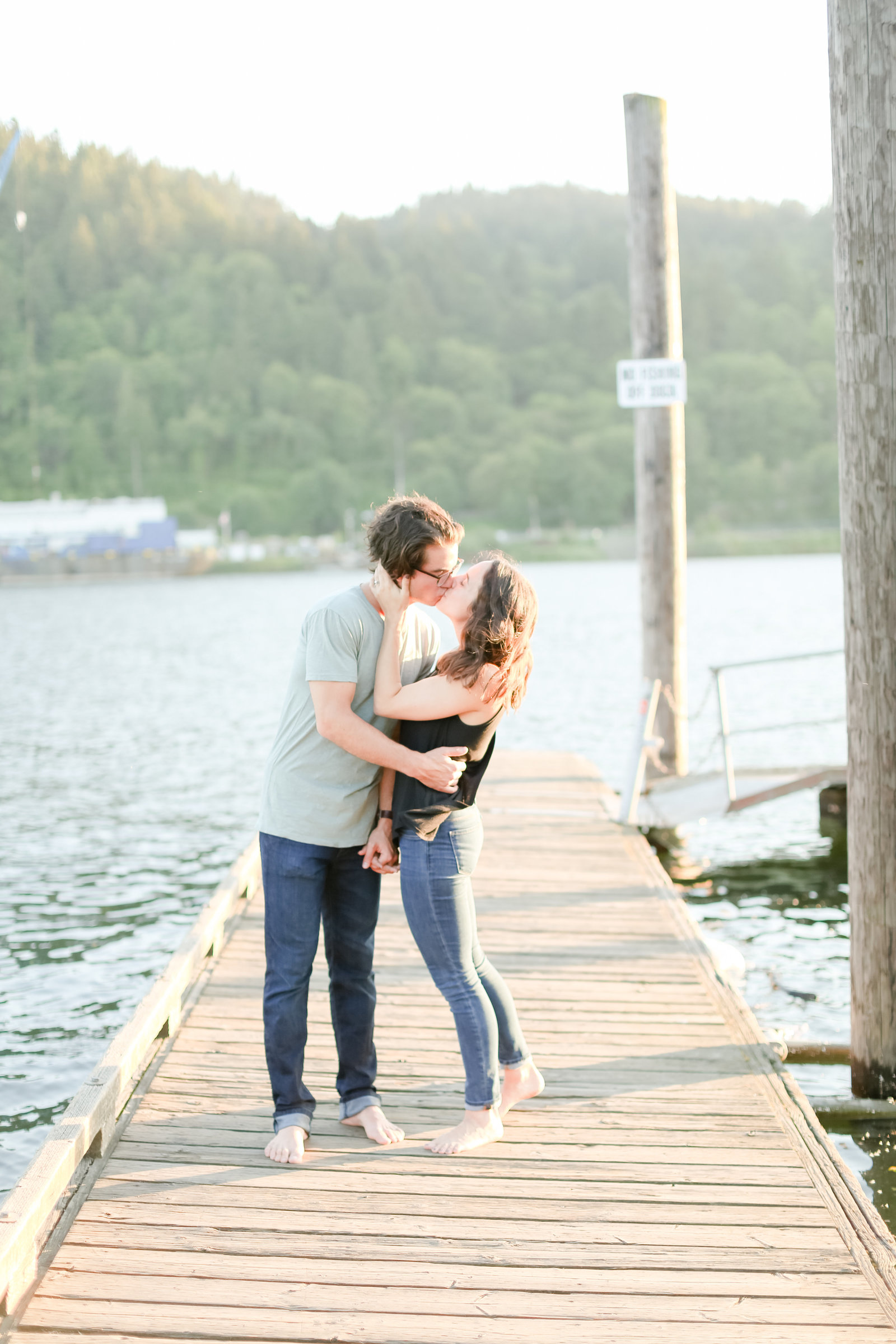 Couple kissing on a dock