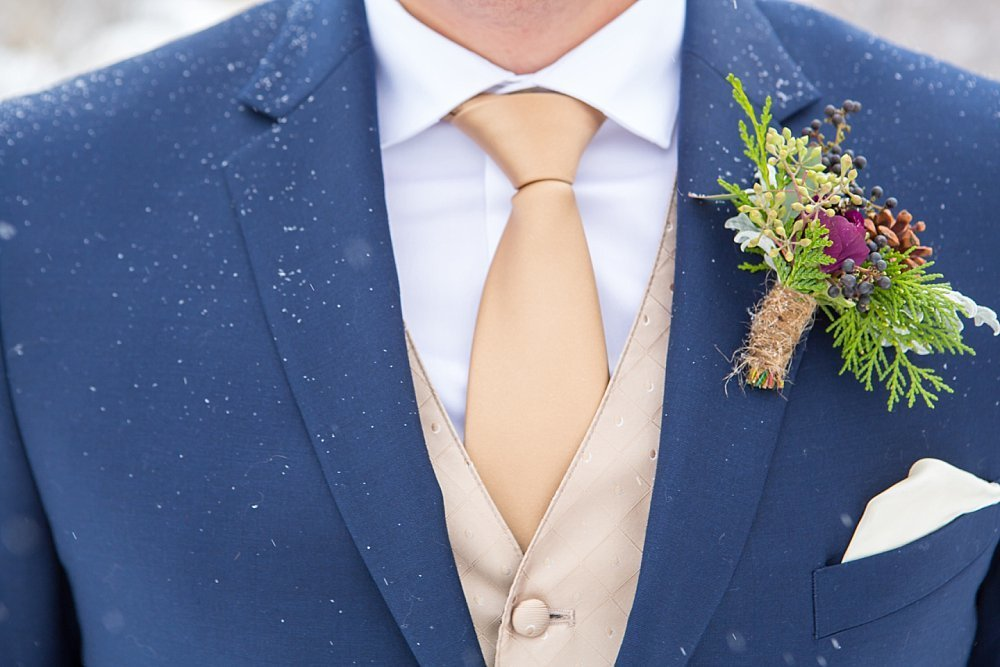 Groom detail with snow