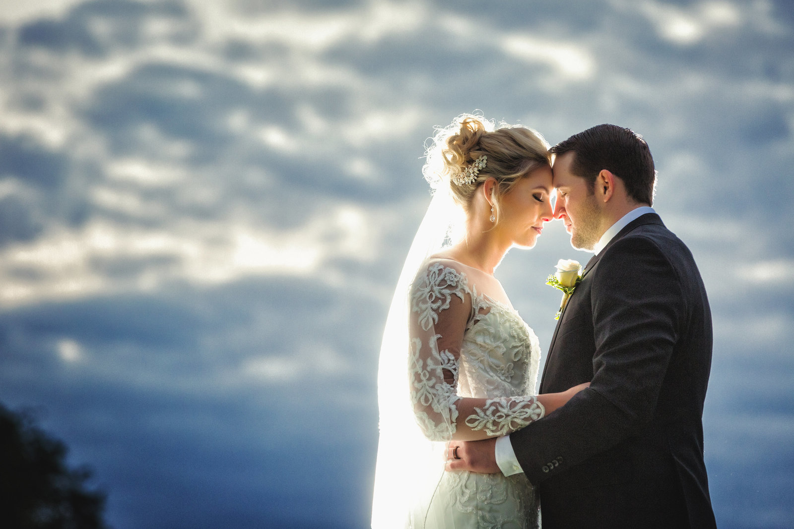 bride and groom romantics  with epic clouds in the background