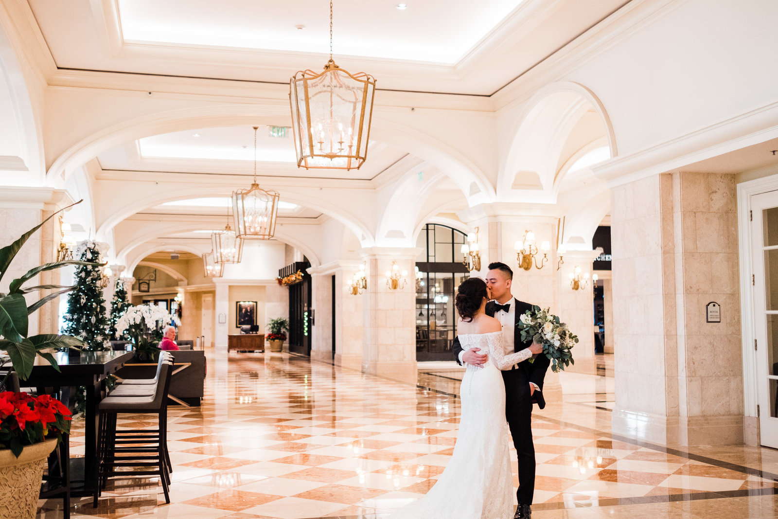Bride and groom kissing in lobby of the marriott orlando