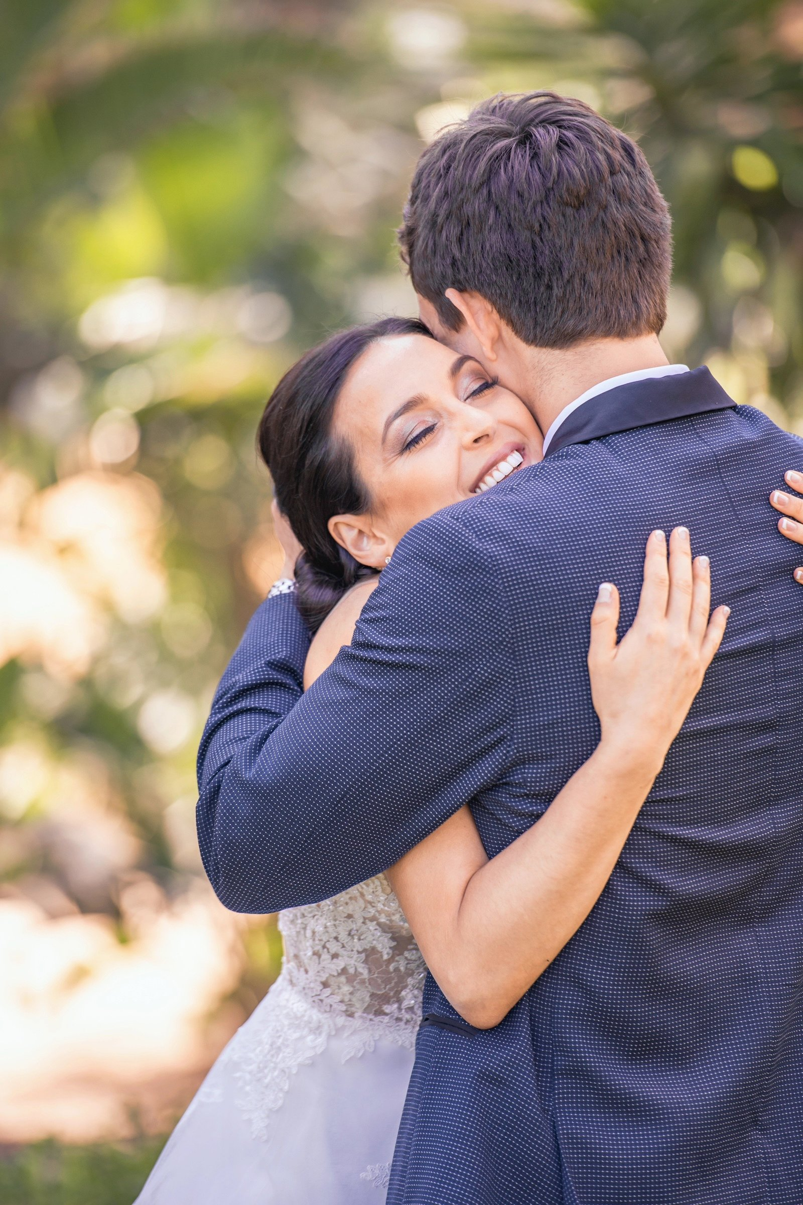 bride and groom hug during first look at los angeles wedding venue