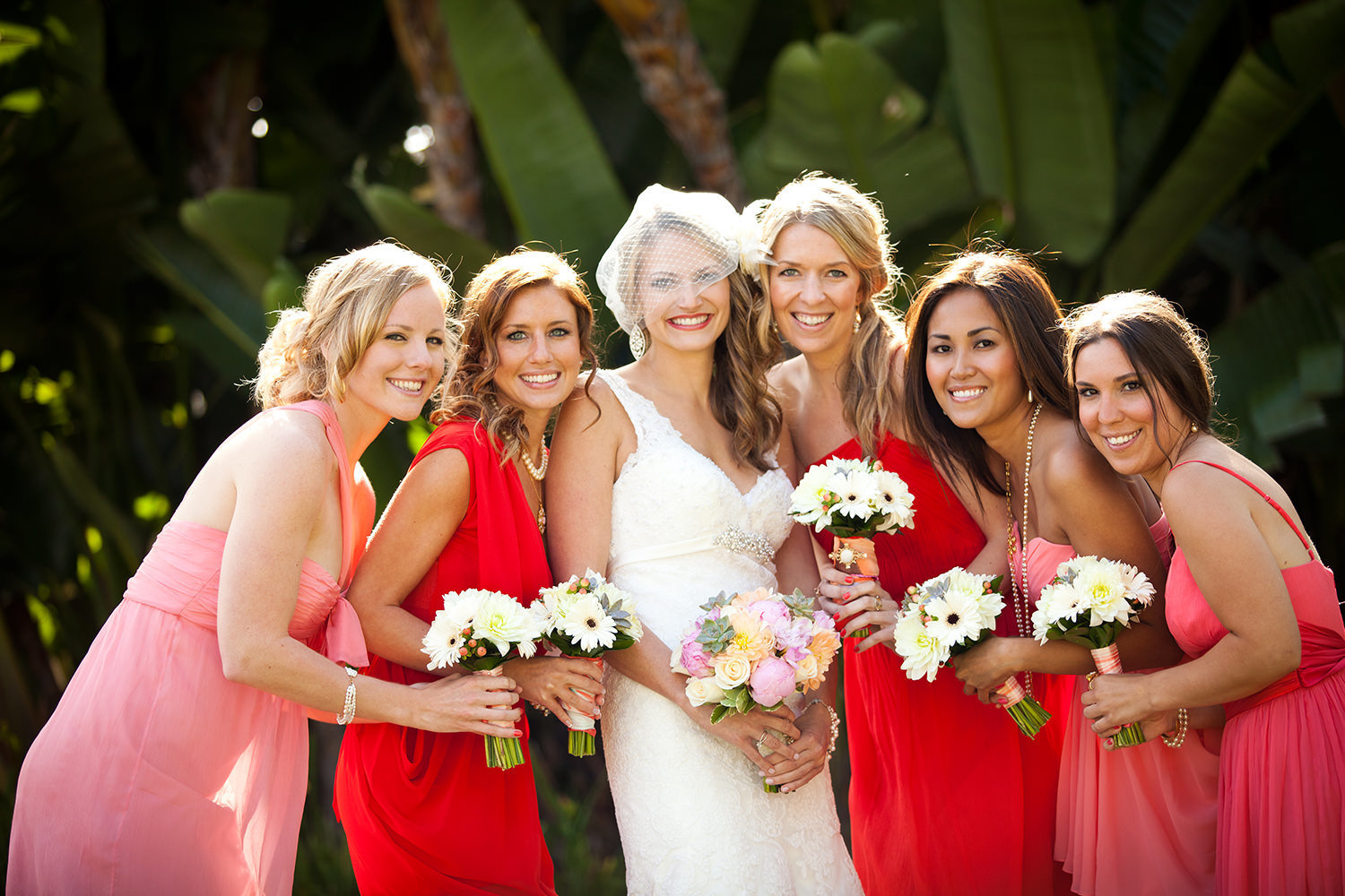 bride with bridesmaids at hilton mission bay with red and pink dresses