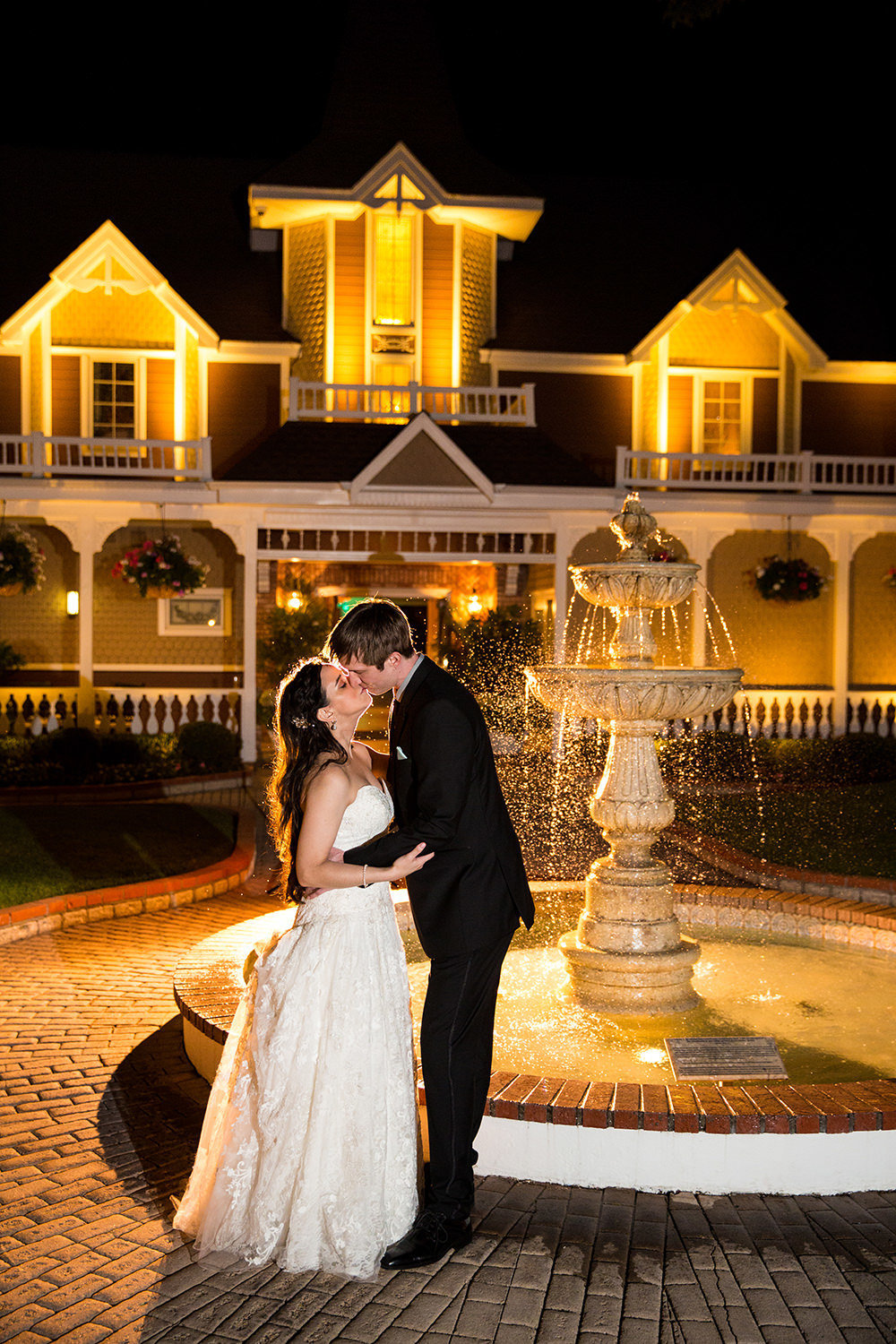 Dramatic night time wedding portrait at the Beverly Mansion