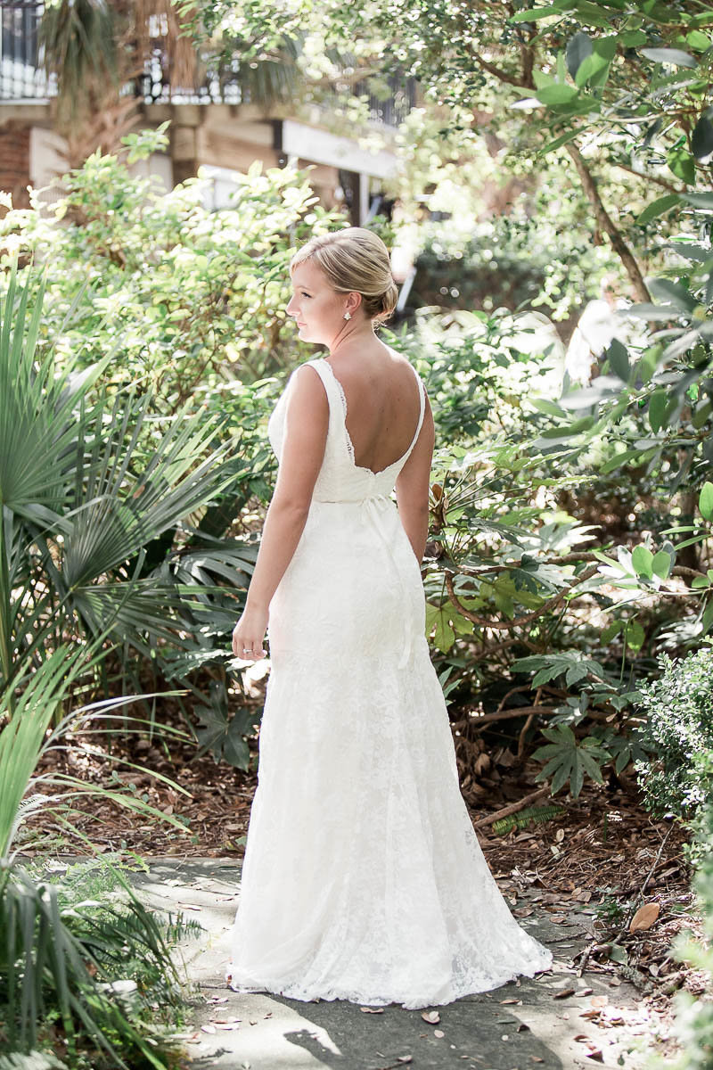 Bride stands among palm trees, Wild Dunes, Charleston, South Carolina