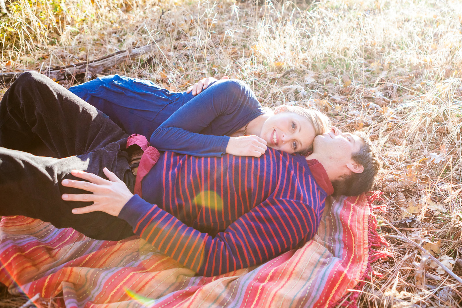 Nevada City Engagement couple snuggling on blanket