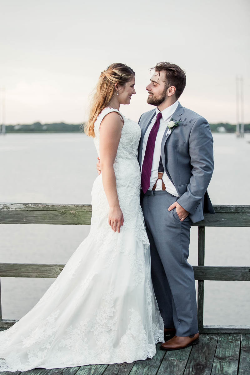 Bride and groom pose at sunset on the dock, The Island House, Charleston, South Carolina
