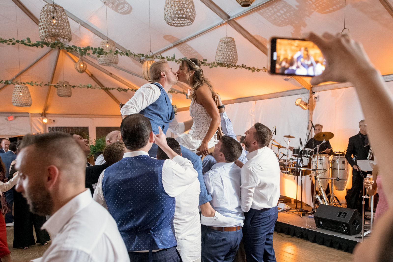 groomsmen holding up bride and groom for chair dance Gurneys Montauk Resort wedding