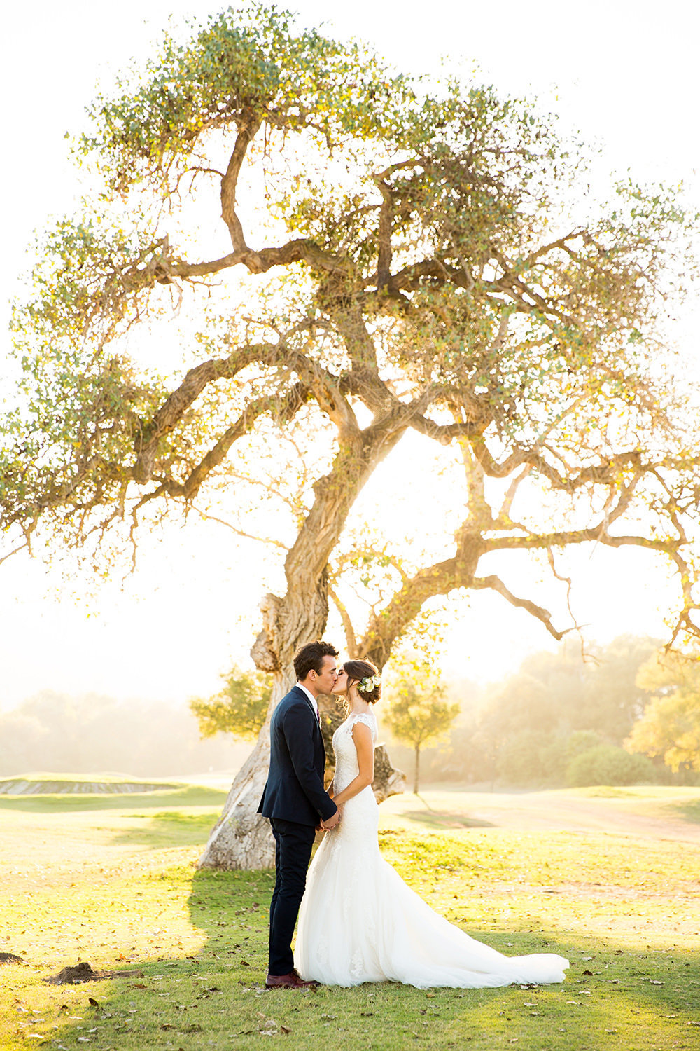 beautiful light with bride and groom at carlton oaks country club with tree
