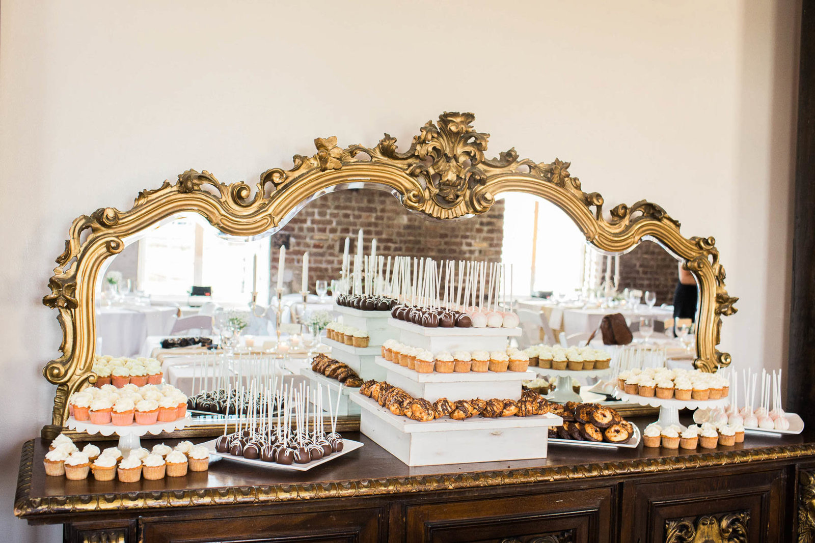 Baked goods are laid out on dessert table, Rice Mill Building, Charleston, South Carolina
