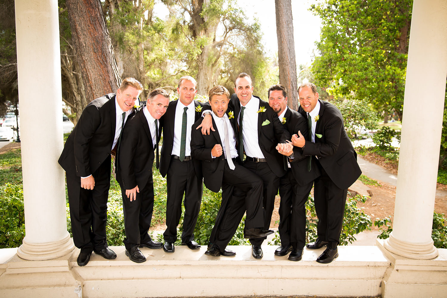 groom being funny with groomsman