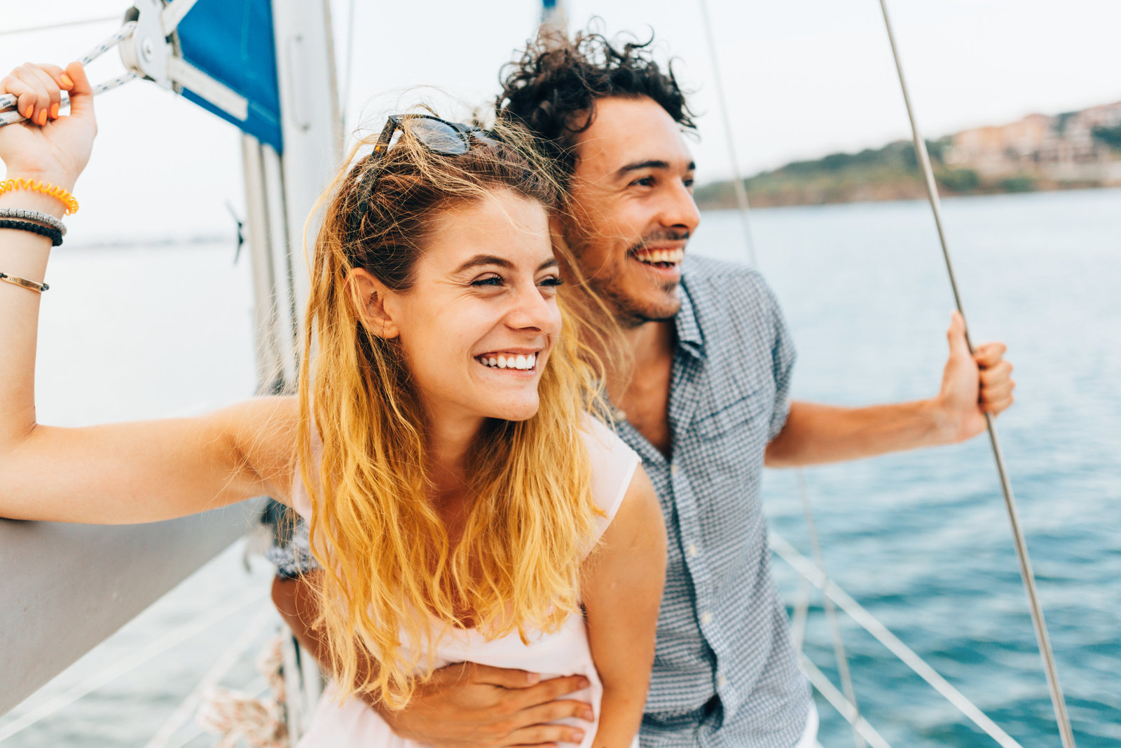Happy couple on sailboat  | Annapolis Orthodontics Annapolis, MD