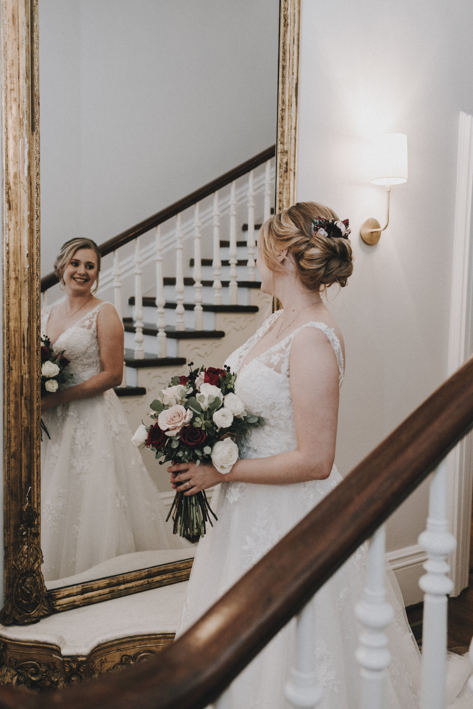 Bridal Portraits looking in mirror at McAllister Leftwitch House in Greensboro NC
