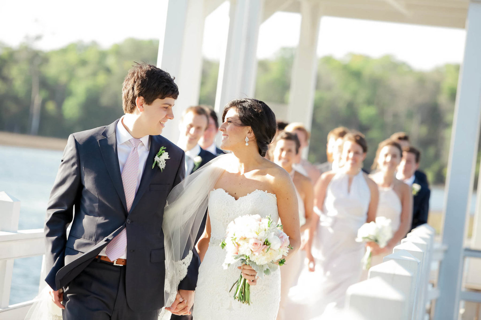 Bride and groom stand on dock, I'on Creek Club, Mt Pleasant, South Carolina