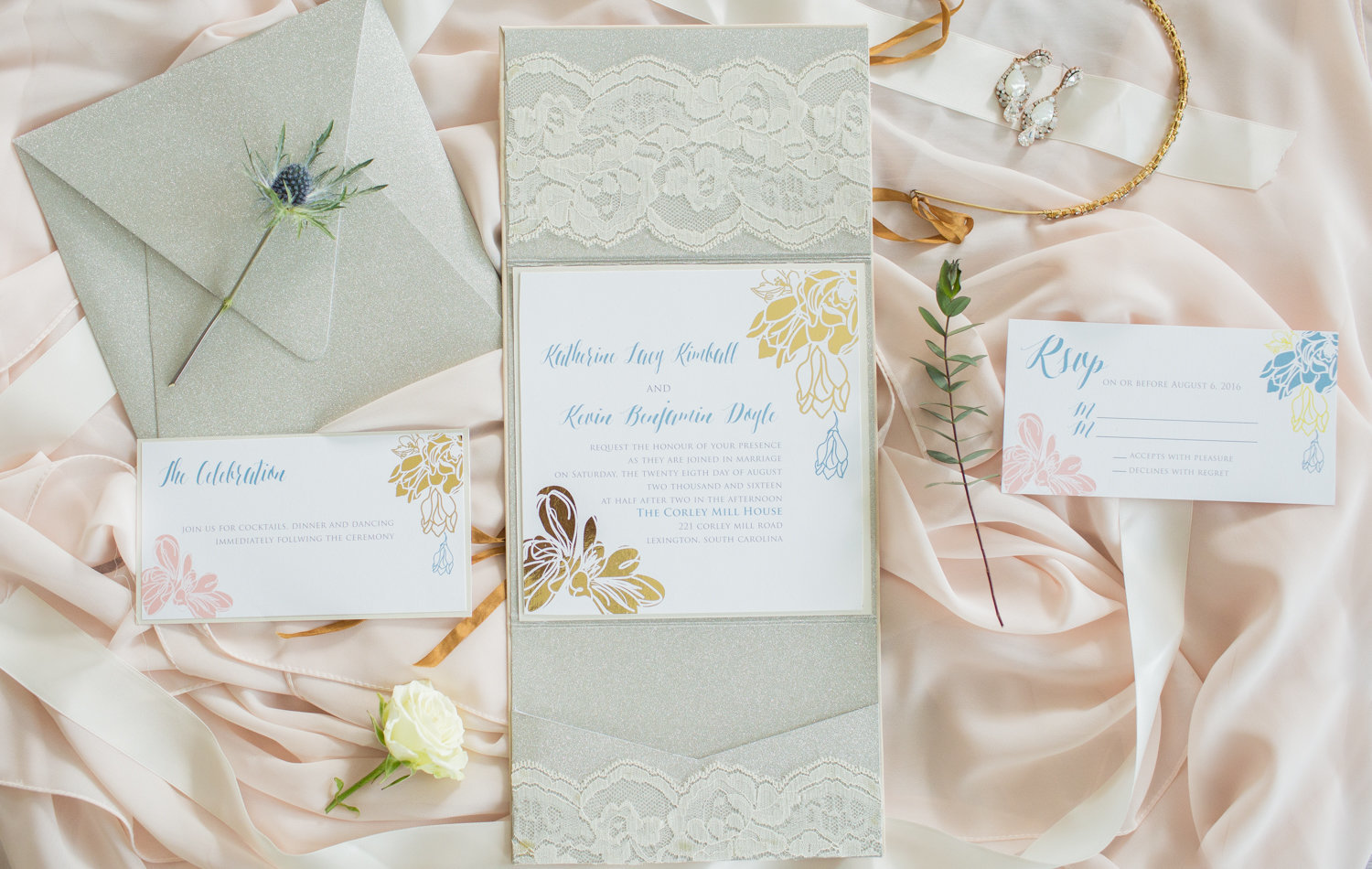 wedding invitation suite with blush background