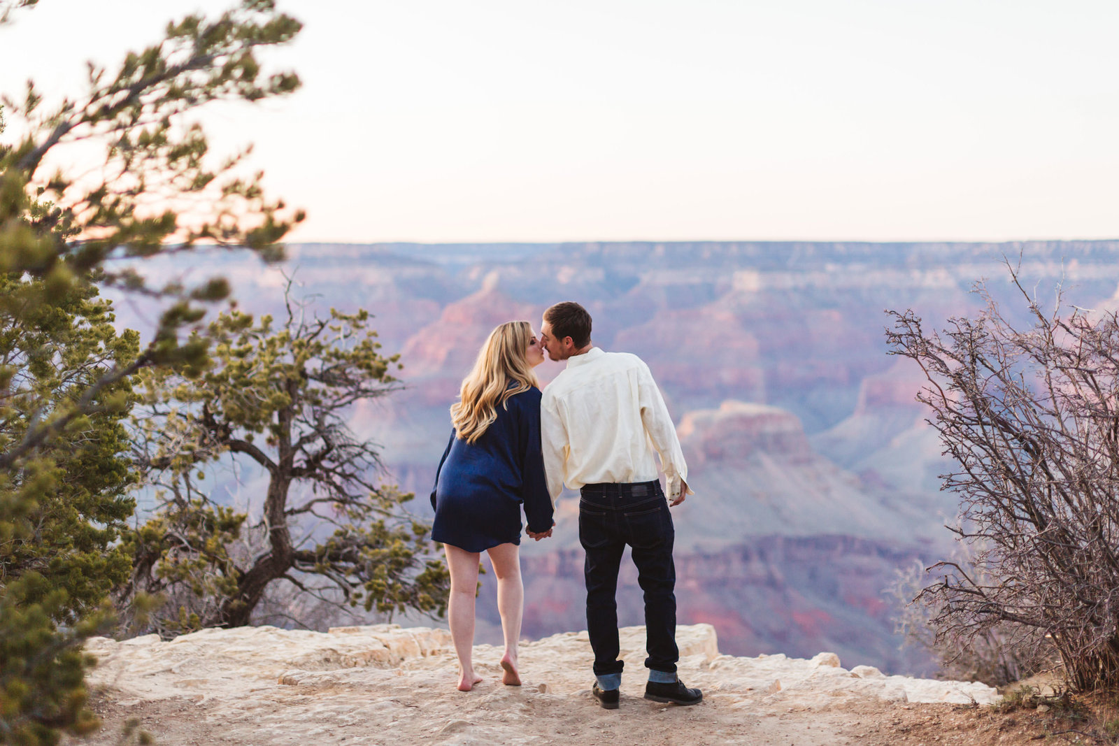 couple kissing in front of grand canyon