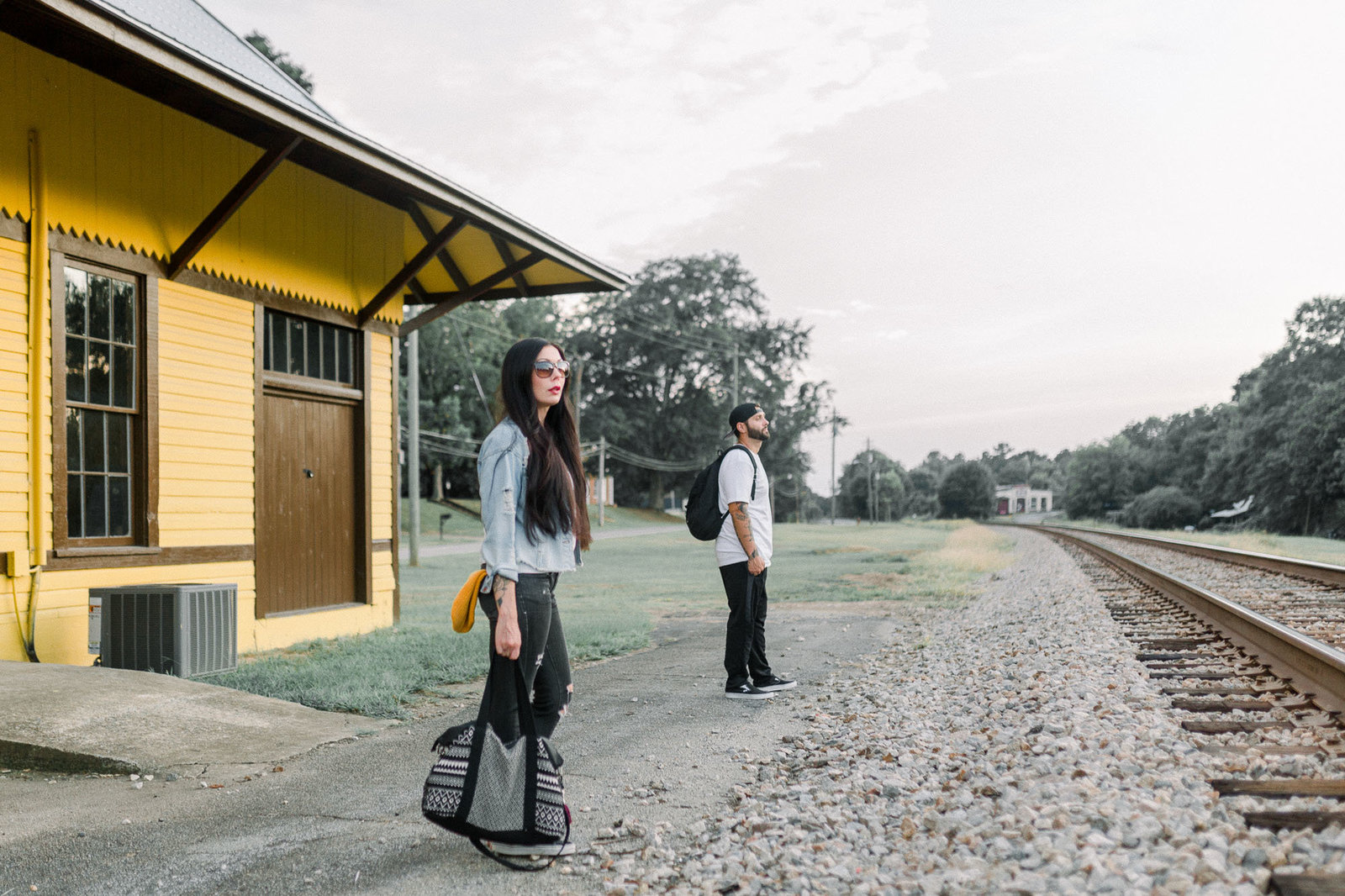 Couple waiting for the train captured by Staci Addison Photography
