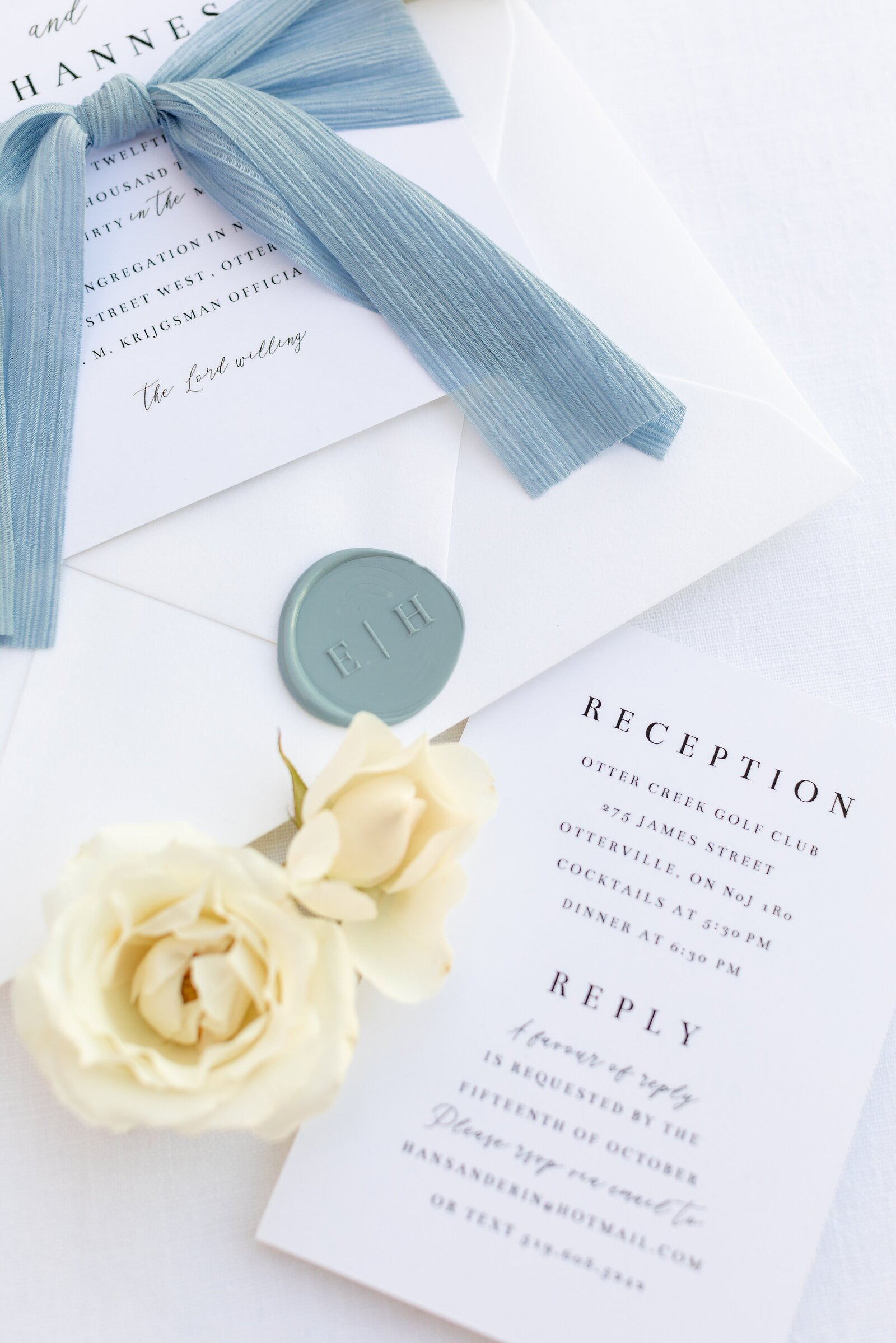 Lavendar-and-lace-designed-wedding-invitations-light-blue-flatlay