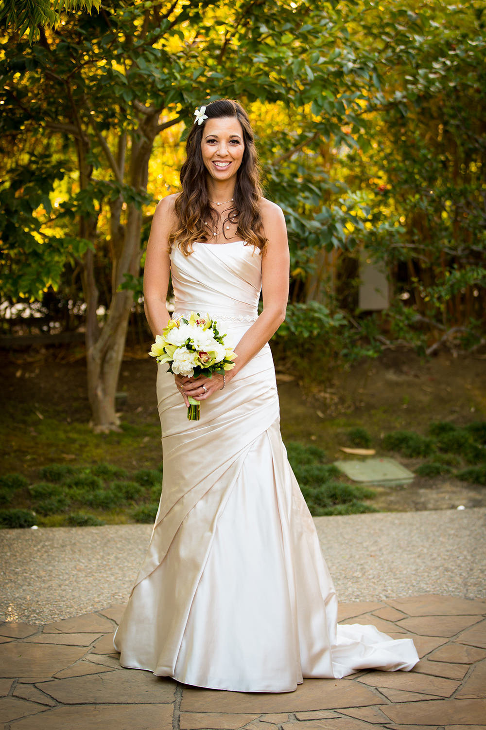 bride with white flowers smiling