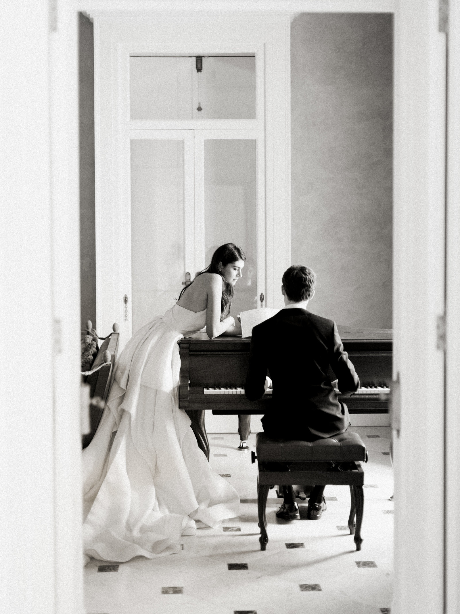 bride and groom playing piano