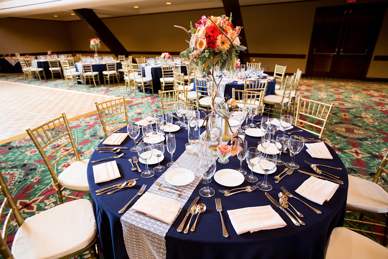 reception table with blue and orange