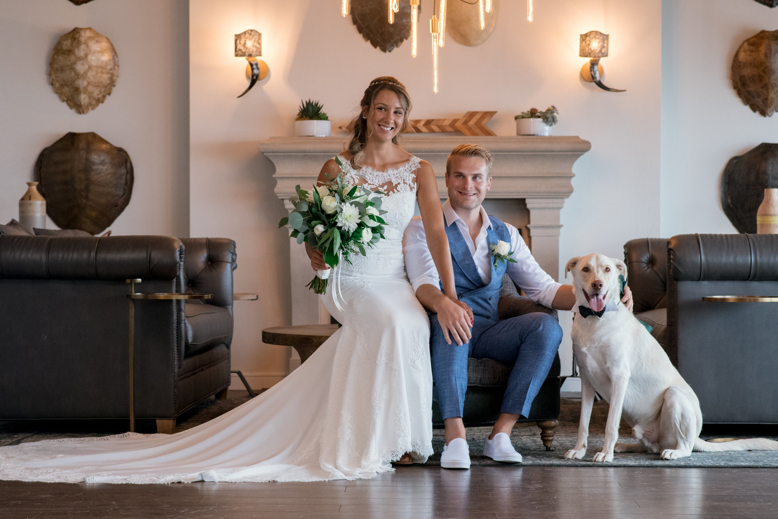 photo of bride and groom with dog inside Gurneys Montauk Resort wedding