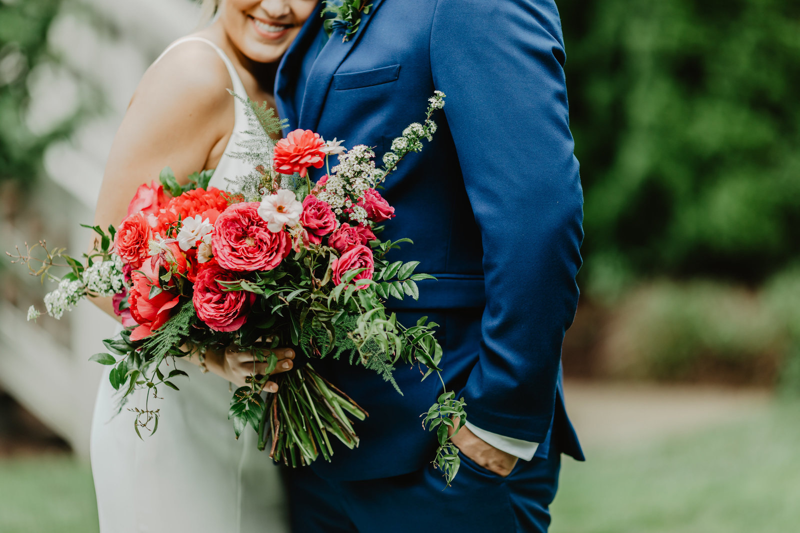 With lush pinks and green this bouquet in the hands of the bride were perfect contrast to the grooms blue suit at the Cordell