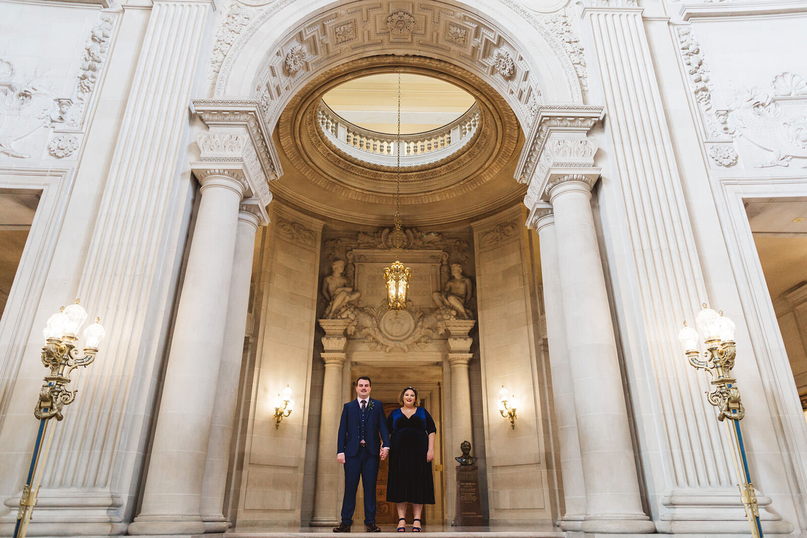 wide shot standing in front of rotunda at sf city hall wedding