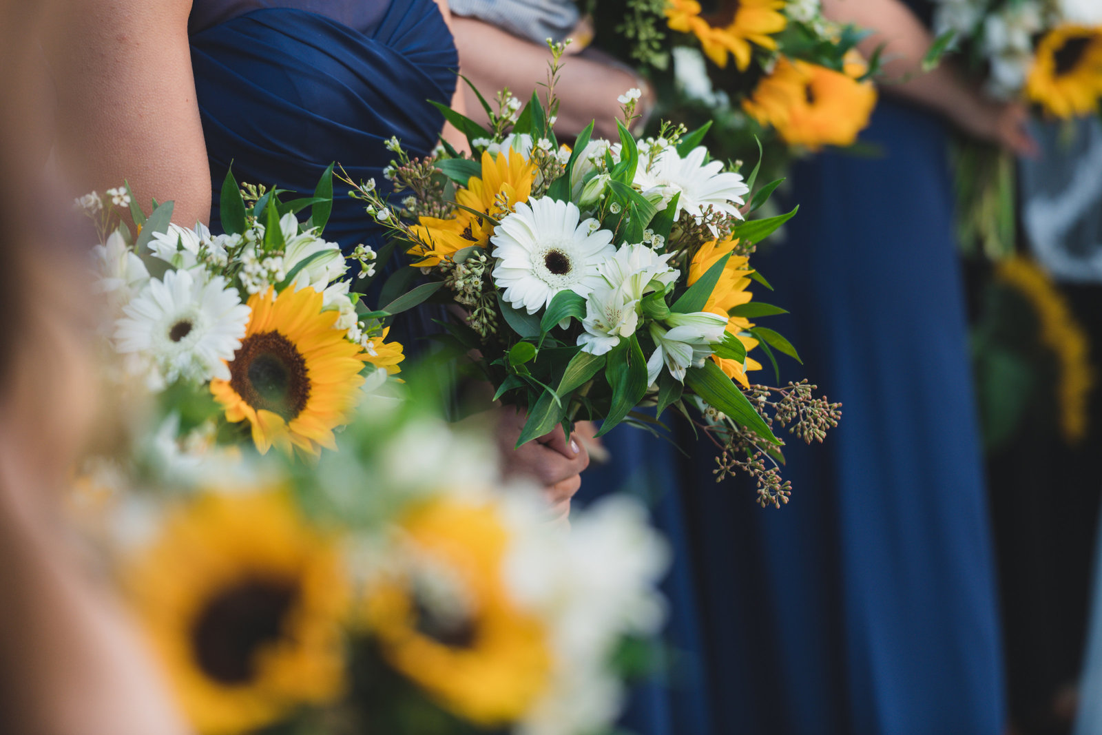 close up photo of bridal bouquets from wedding at Three Village Inn