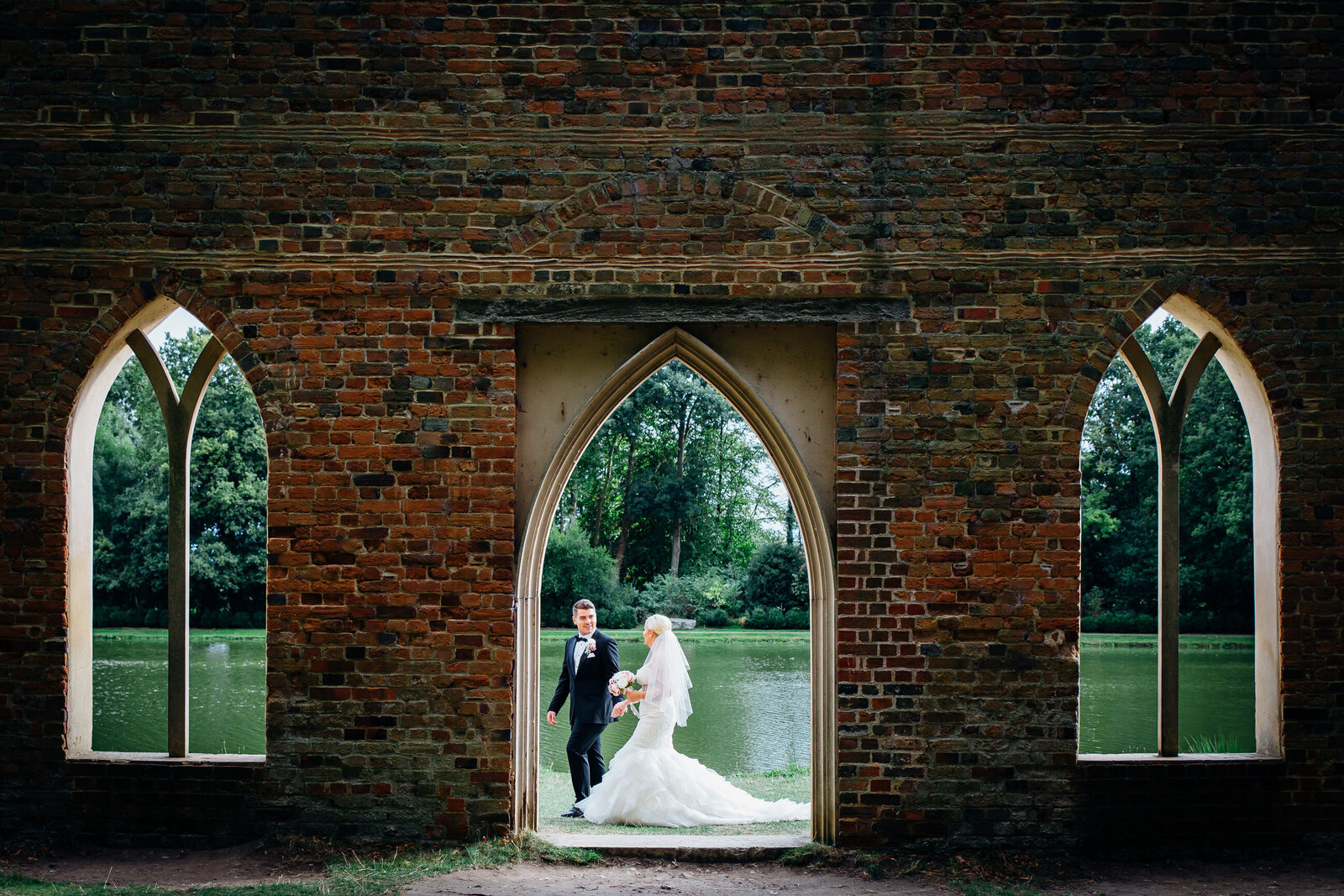 Wedding photography at Painshill Park Surrey. Bride and groom walking in grounds. Photography by Lynsey Grace Photography