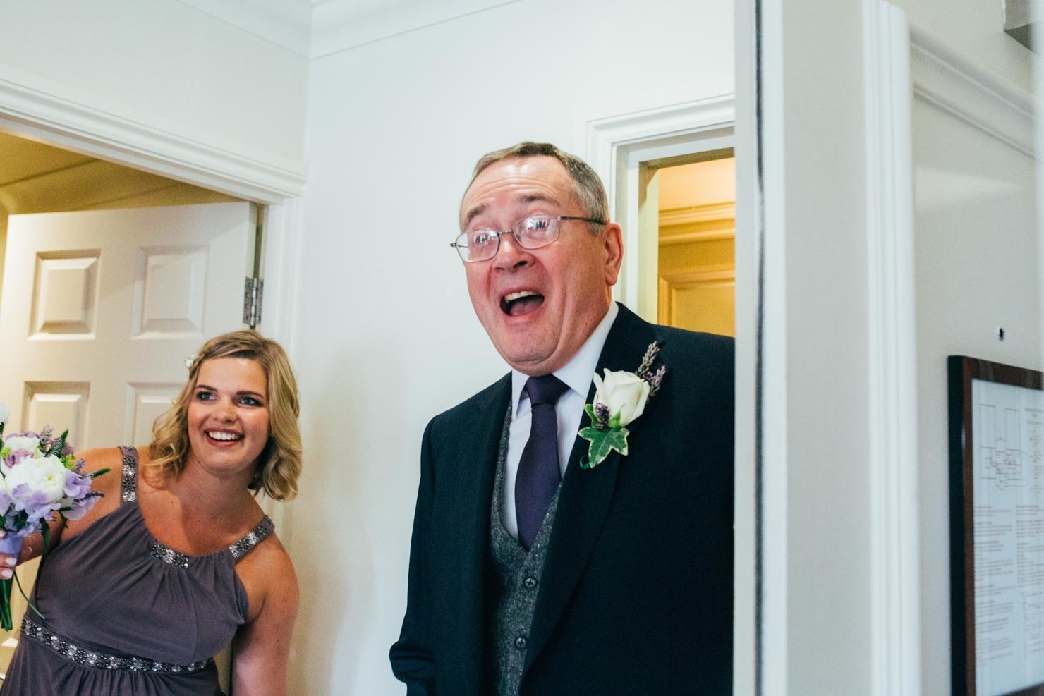 Father of the groom natural look of joy as he sees the bride for the first time