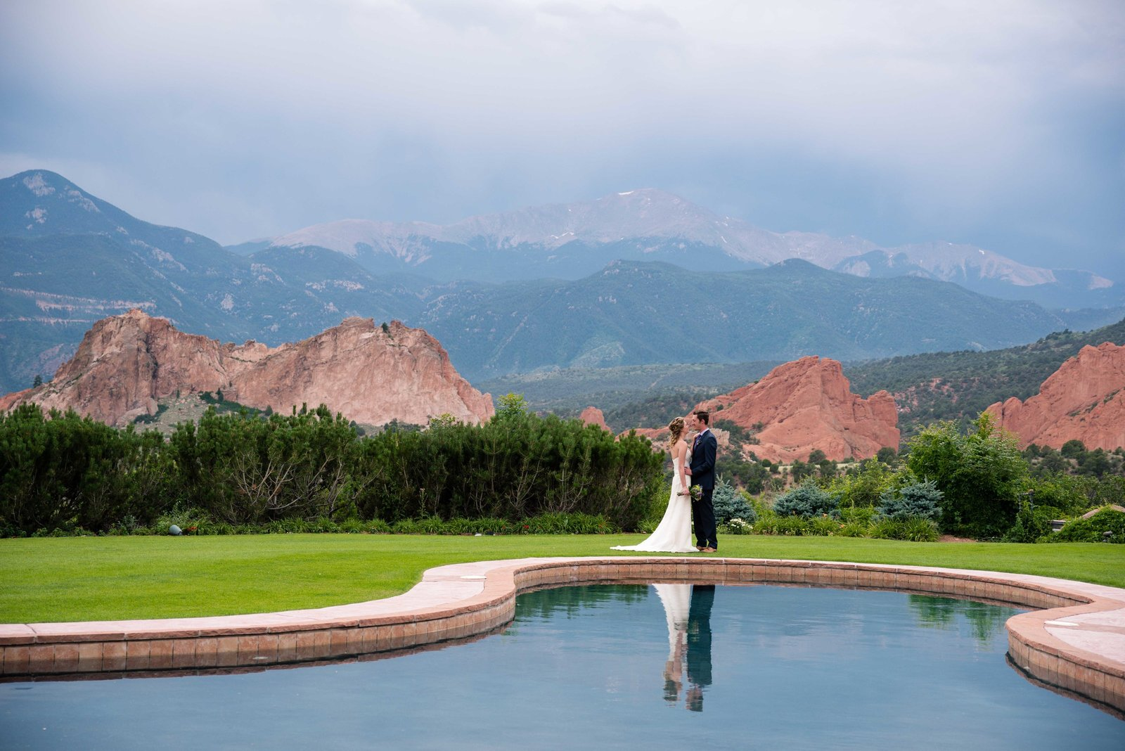 amazing wedding couple in the mountains reflected in water