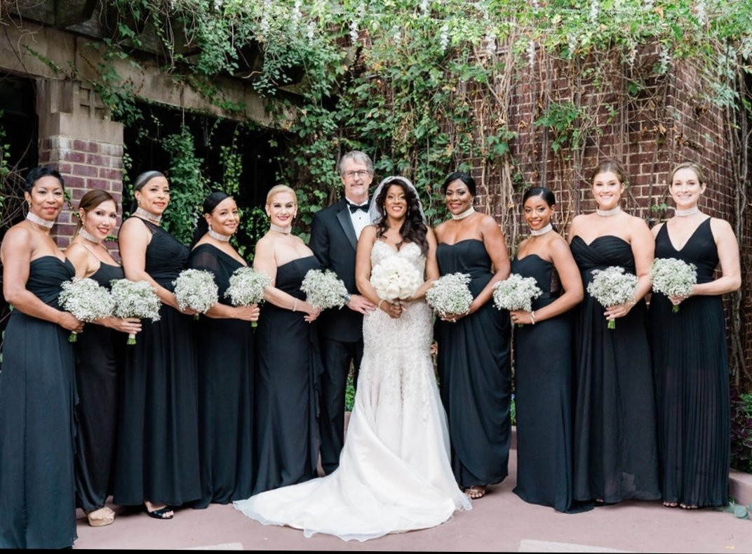 Bride, groom and bridesmaids with classic bouquets
