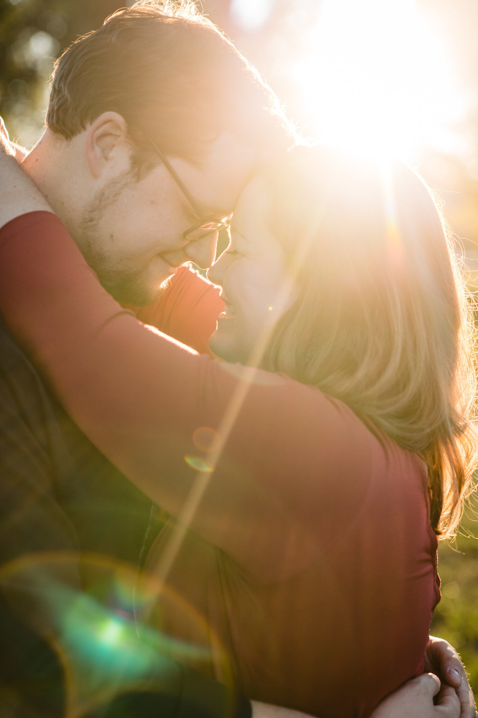 couple embracing in sunlight