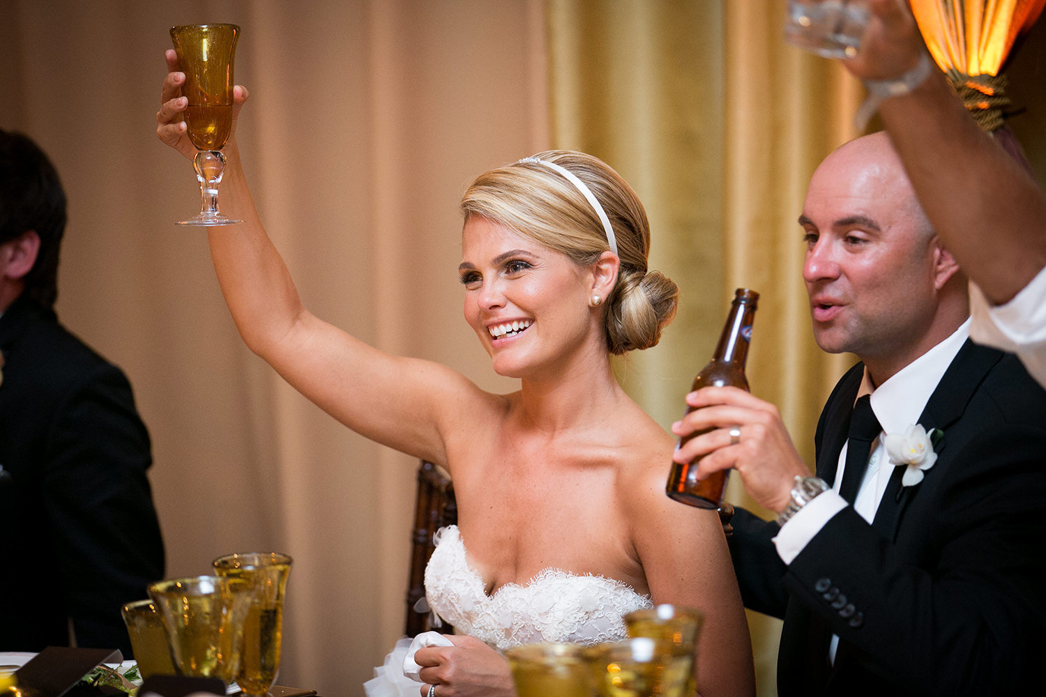 Cheers!  Toasts during the wedding reception at St. Regis Resort\