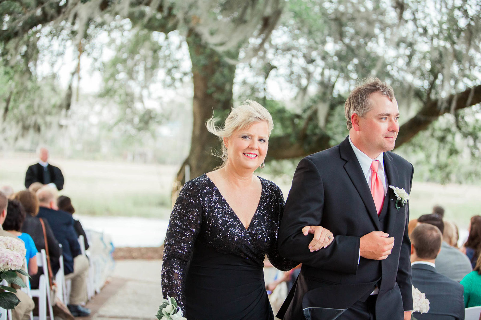 Mother is escorted down the aisle, Dunes West Golf and River Club, Mt Pleasant, South Carolina. Kate Timbers Photography.