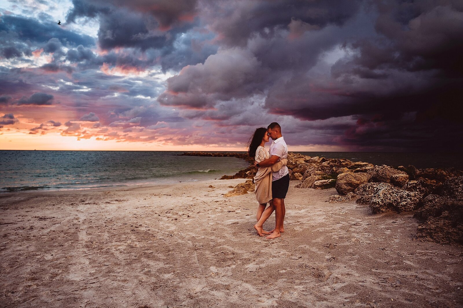 couple embraces after a storm on Clearwater Beach