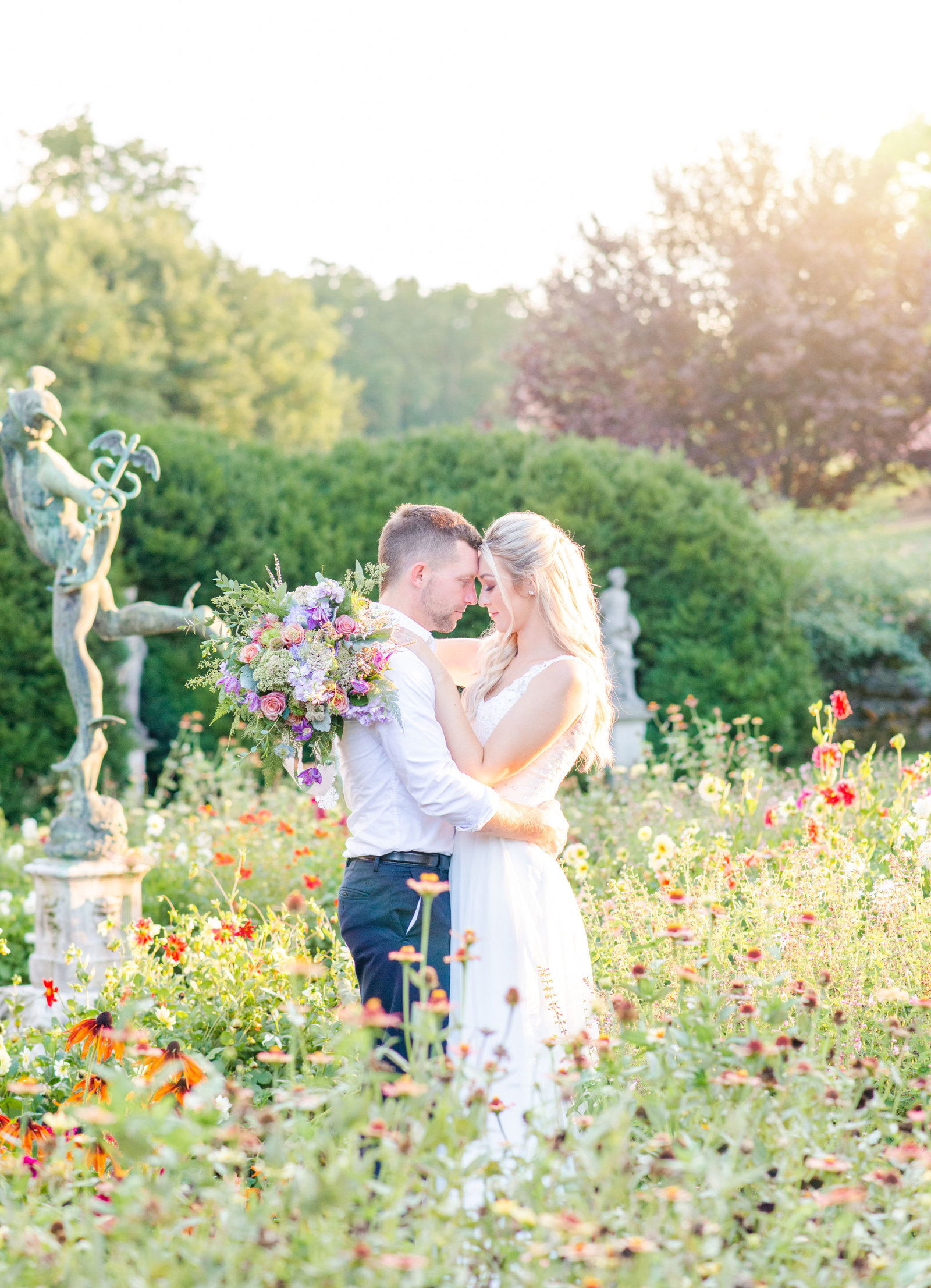 Wedding couple embracing in garden