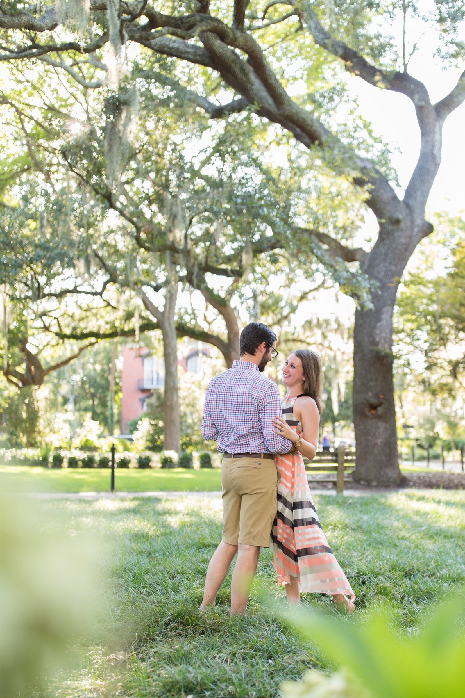 engaged couple at forsyth park in savannah