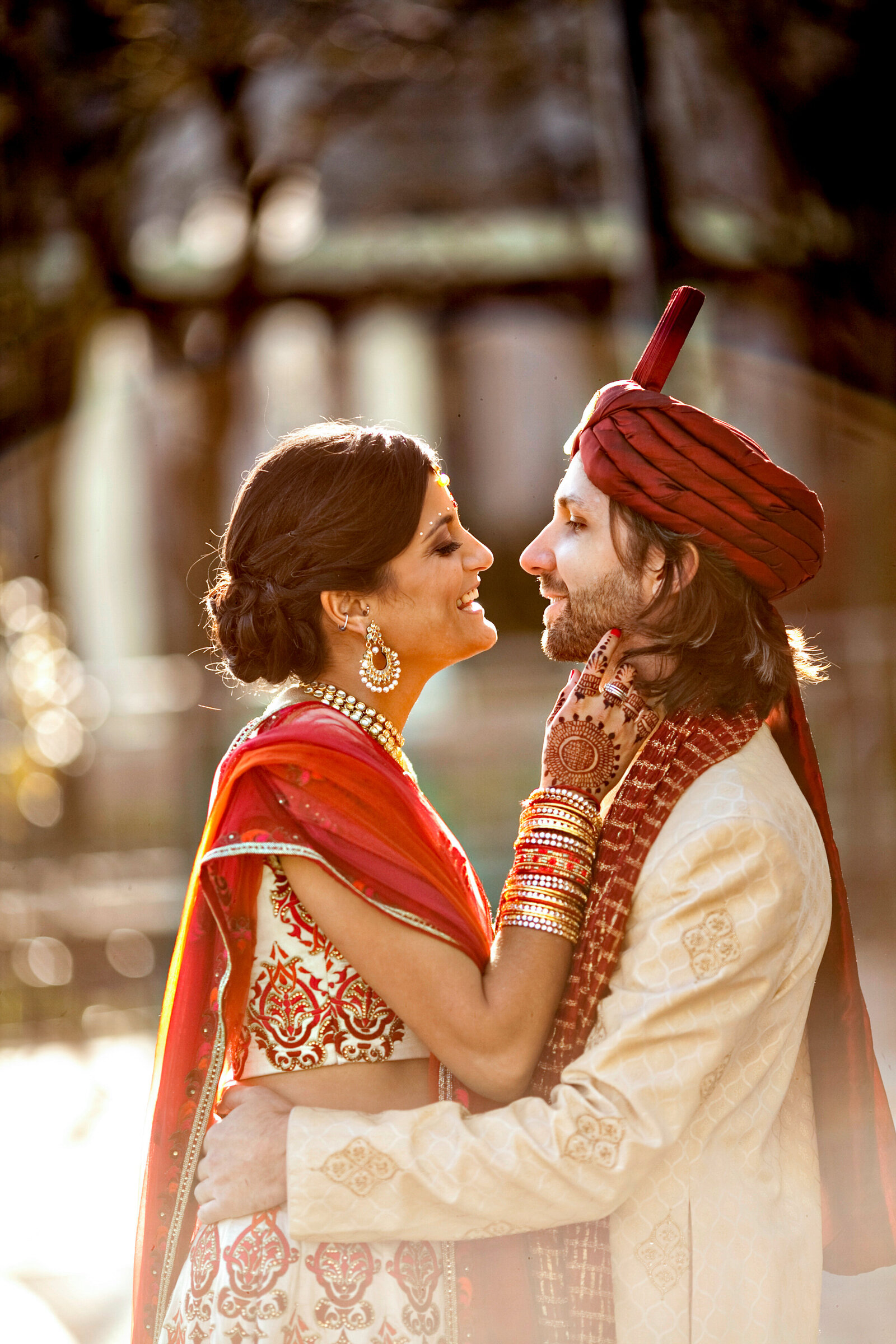 indian bride and groom with red sari