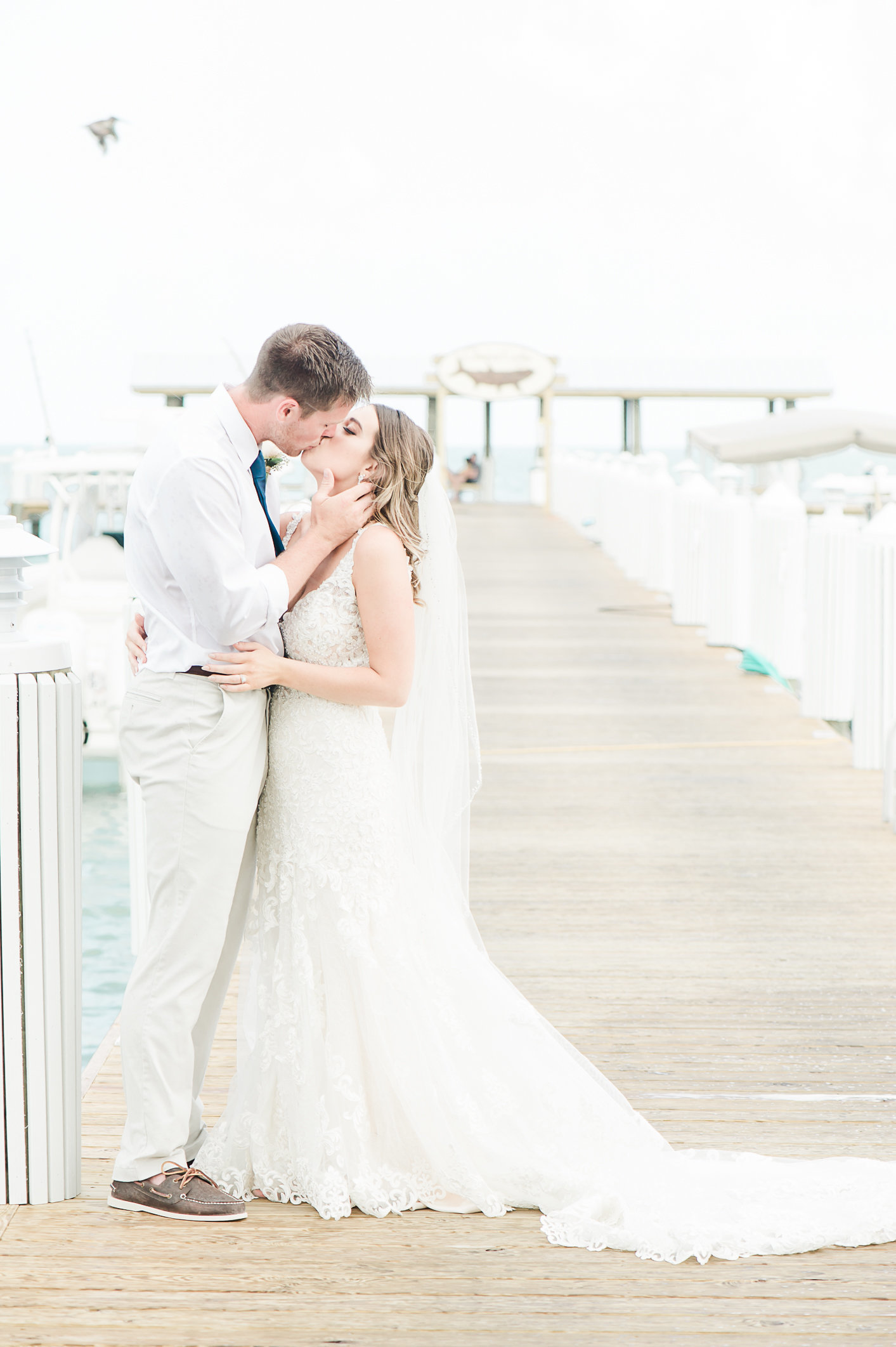 Couple on Pier - Cheeca Wedding - Palm Beach Wedding Photography by Palm Beach Photography, Inc.