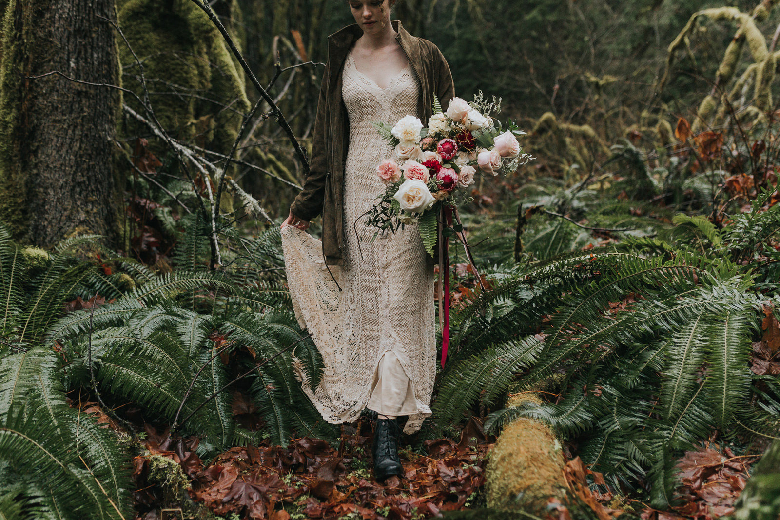 boho bride walking through forest in Washington