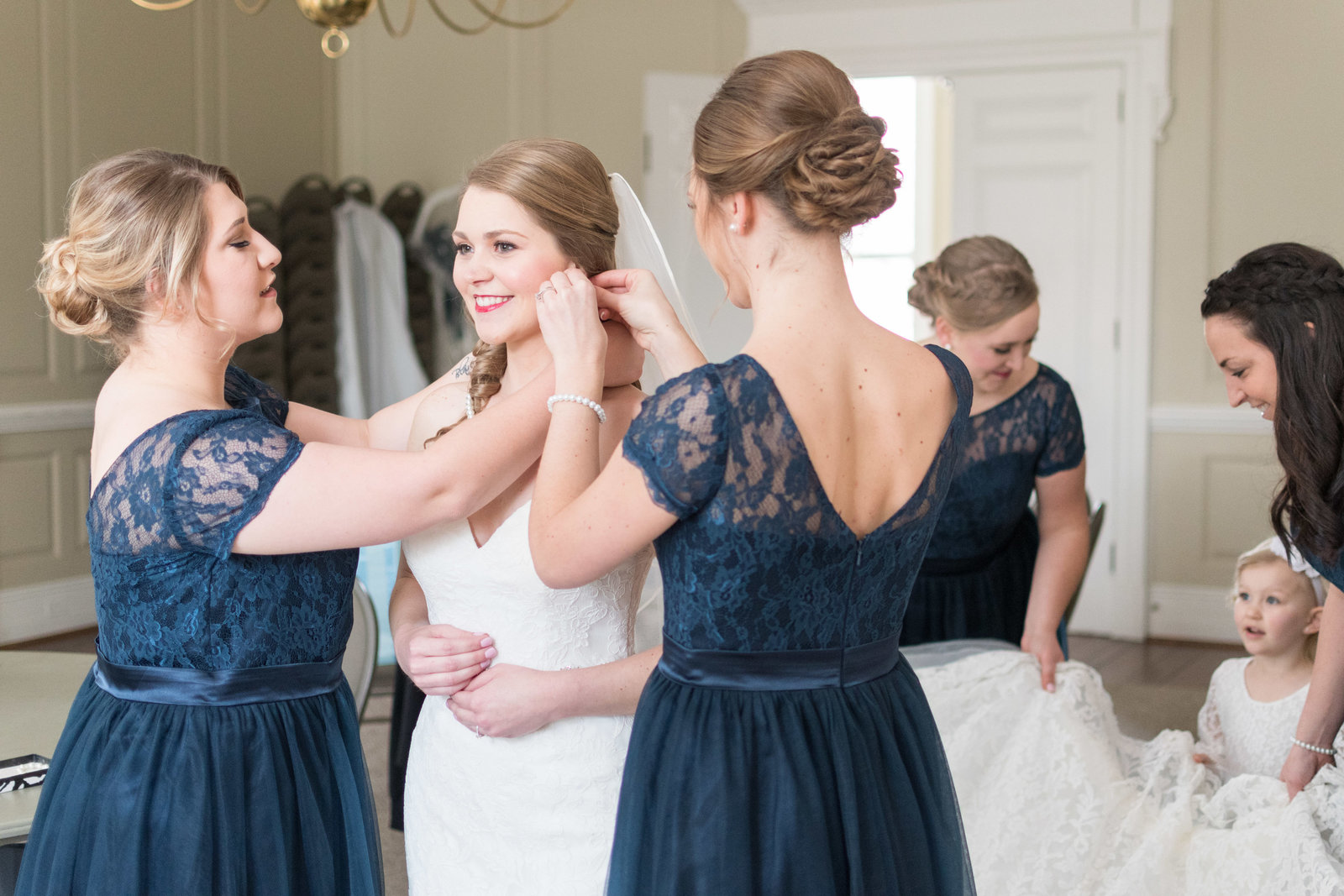 charlotte wedding photographer shot of bride getting ready with bridesmaids